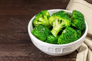Cooked green broccoli with sea salt and copyspace