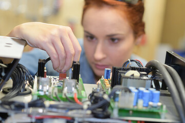Woman working on electrical system