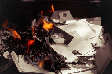 Fire from the torn photos and letters (a rupture of the relations)