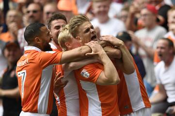 Blackpool's Brad Potts celebrates scoring their first goal with team mates