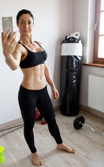 Sportive woman taking selfie.
