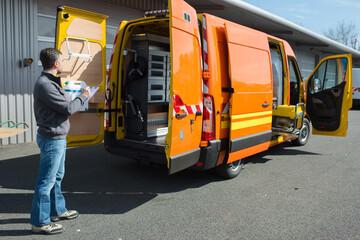 Poster Channel Mobile mechanic behind his van
