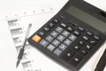 Calculator and pen and document on the white background.