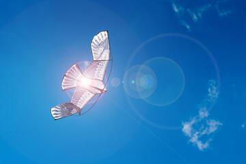 Fotobehang Bloemen Flying kite on a blue sky background