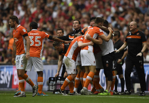 Blackpool's Mark Cullen (C) celebrates scoring their second goal as Gary Bowyer looks up