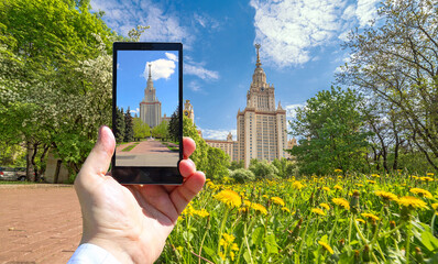 Conceptual view of large diversity of Moscow state university viewed through smart phone screen in human hand