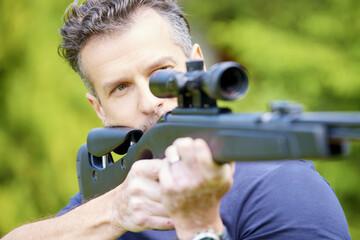 Man using airgun
