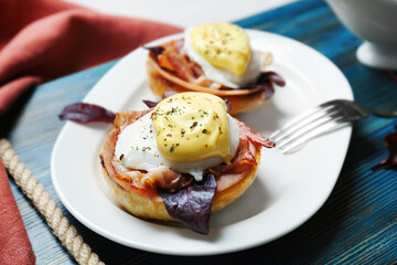 Tasty eggs Benedict on plate