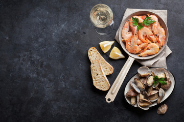 Canvas Prints Seafoods Fresh seafood on stone table. Scallops and shrimps