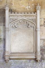 Ornate carved stone frame