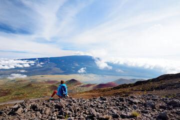 Tourist admiring breathtaking view of Mauna Loa volcano on the Big Island of Hawaii, USA