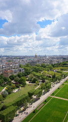 Aerial view of Champ de Mars gardens from Eiffel tower with beautiful scattered clouds, Paris, France