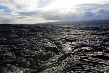 Endless lava fields of the Big Isalnd of Hawaii. Smooth, undulating surface of frozen pahoehoe lava.