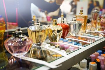 Different perfume bottles in modern shop