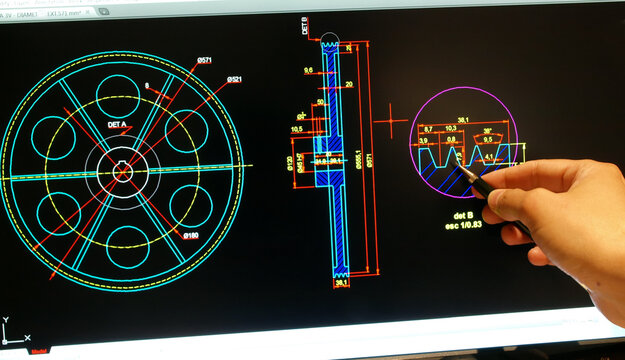 enginer designing on computer a mechanical piece detail