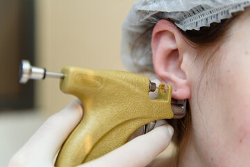 Ear piercing girl.