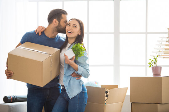 Young couple moving to a new apartment together relocation