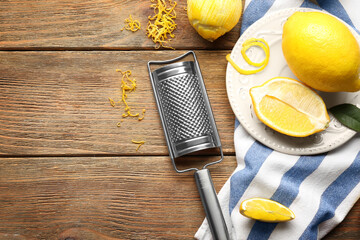 Composition with lemons and grater on wooden table