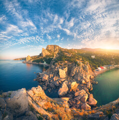 Wall Mural - Amazing mountain landscape at sunrise. Beautiful view from the mountain peak on the blue sea, high rocks, beach, forest and colorful blue sky with clouds in summer. Travel in Europe. Seascape