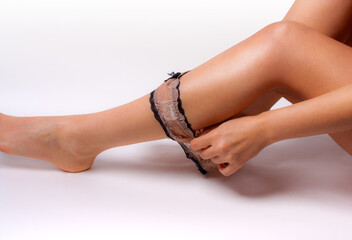 Female legs with panties deflated isolated on white.