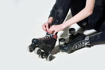 roller skates on woman or girl in black tie laces
