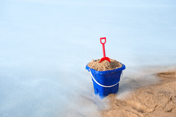 Beach bucket in sand
