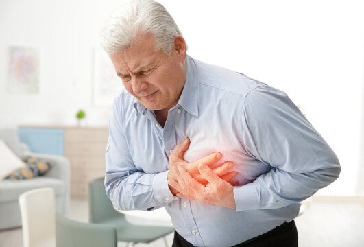 Man with chest pain suffering from heart attack in office