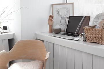 Creative workplace on windowsill in modern room
