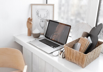 Creative workplace on windowsill in modern room