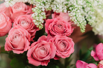 Bunches of amazing pink roses and white lilac