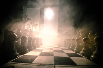 chess board game concept of business ideas and competition and strategy ideas concep. Chess figures on a dark background with smoke and fog. Selective focus. Hand puts figure on board