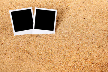 Summer holiday instant camera photo frame prints on a beach sand background