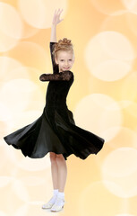 Beautiful little dancer in a black dress.
