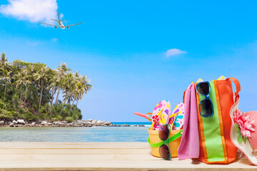 Beach accessory,hat,sunglasses,shoes,umbrella on wooden, concept summer holiday background and summer sale.