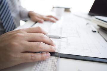 Men are creating design drawings