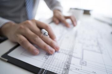 Men draw drawings using rulers