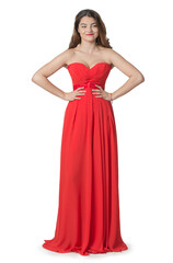 emotional Asian girl in red dress in full growth on an isolated background
