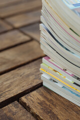 Stack of old magazines on wooden background