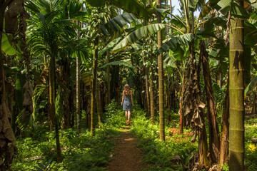 Young woman in the jungle in tropical spice plantation, Goa, India