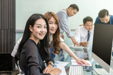 Group Of Asian Business people with casual suit working and talking together in the modern Office, people business group concept
