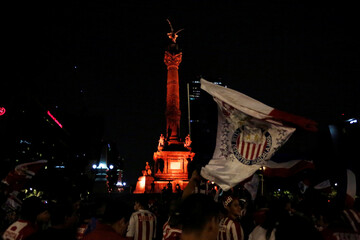 Fans of Chivas de Guadalajara celebrate at the Angel de la Independencia monument  after winning the Mexican First Division Final, in Mexico City