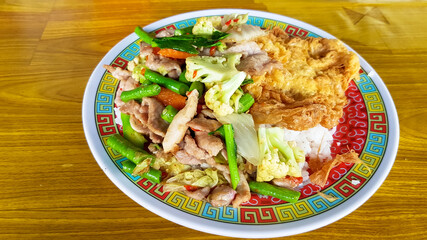 fried mix vegetable with pork and omelet on rice