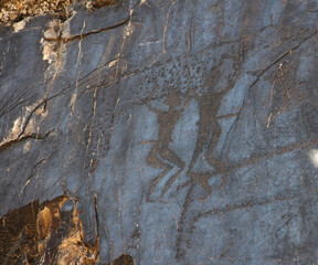 ancient rock drawings (petroglyph), two dancing human