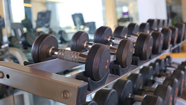 Closeup of dumbbells in gym.