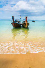 Amazing view of beautiful beach with traditional thai longtale boats. Location: Krabi, Thailand, Andaman Sea. Artistic picture. Beauty world.