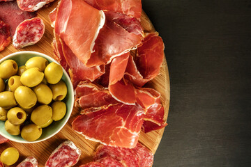 Overhead photo of Spanish cold meats platter with copyspace