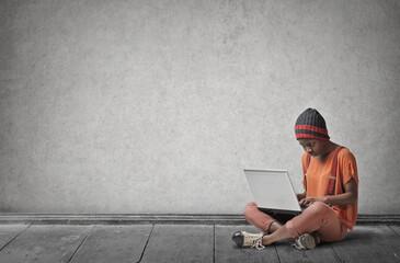 Urban girl using a laptop