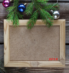 Christmas background and Christmas wooden frame. Christmas decorations on a white vintage wooden background. Free space for text