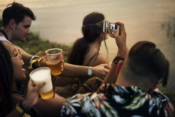 Group of Friends Drinking Beers Enjoying Music Festival Together