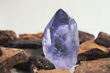 Large quartz crystal on white background close-up